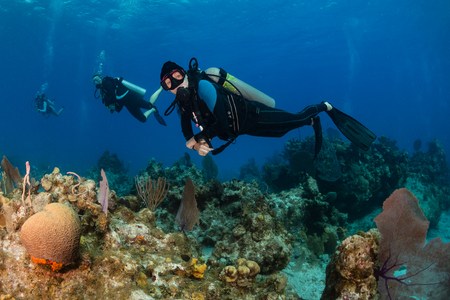 Female SCUBA diver on a tropical coral reef