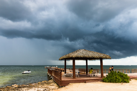 Tropical thunderstorm off a small beach