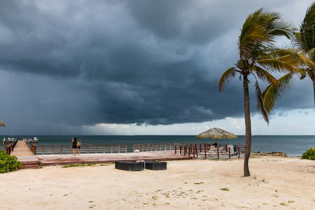 Tropical thunderstorm off a tropical beach Stock Photo