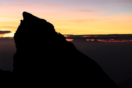 crater lake: Sunrise on Agung with Mount Rinjani piercing the clouds in the distance