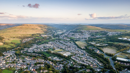 Sunset over a welsh valleys town Stock Photo