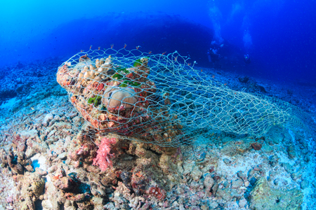 An abandoned Ghost fishing net stuck on a tropical coral reef