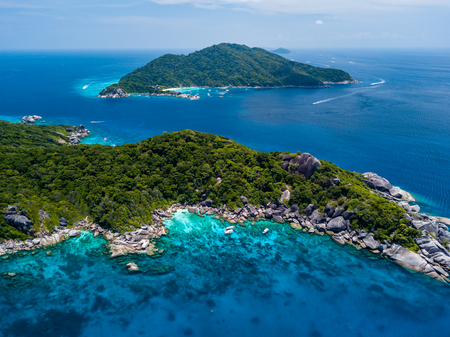 Aerial view of beautiful jungle covered tropical islands with coral reefs (Similan Islands, Thailand)