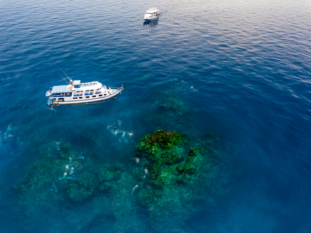 Aerial view of dive boats over Richelieu Rock - Thailands top scuba diving site