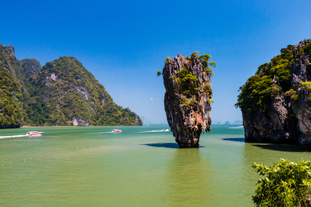 Beautiful limestone cliffs and jungle jutting out of a shallow tropical ocean