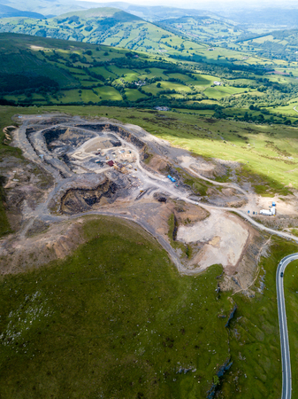Aerial drone view of an old quarry scarring the otherwise green landscape in the Brecon Beacons national park Stock Photo