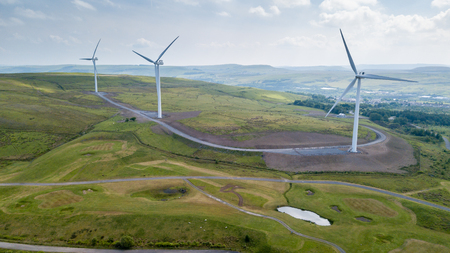 Aerial view of large wind turbines on a rural hillside in Wales Foto de archivo