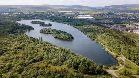 Aerial view of Bryn Bach park and lake in Tredegar, South Wales