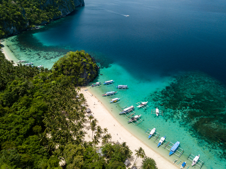 Aerial drone view of the scenic 7 Commando and Papaya beaches in El Nido, Palawan Stock Photo