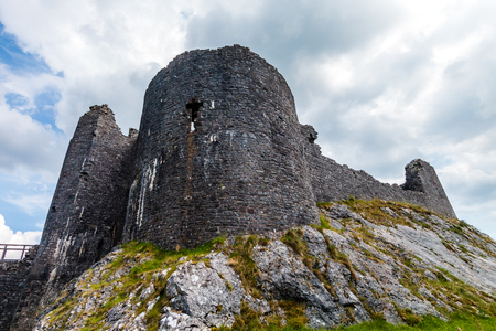 Ruins of an ancient medieval castle on a hillside (Carreg Cennen, Wales, UK)
