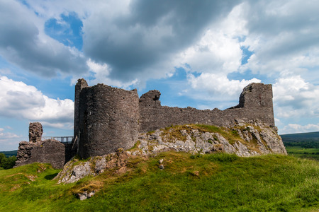 Imposing exterior walls of an ancient ruined castle (Carreg Cennen, Wales)