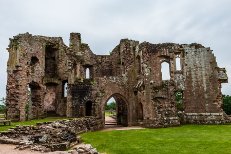 Walls and towers of a ruined ancient medieval castle (Raglan Castle) Stock Photo