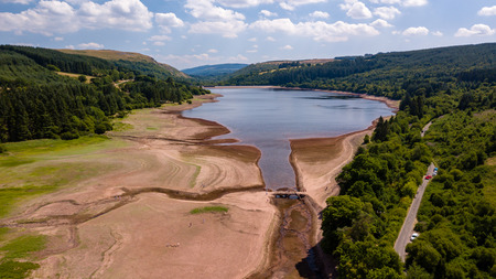 Aerial drone view of a dried up reservoir in the Brecon Beacons during a summer heatwave (Llwyn-On)