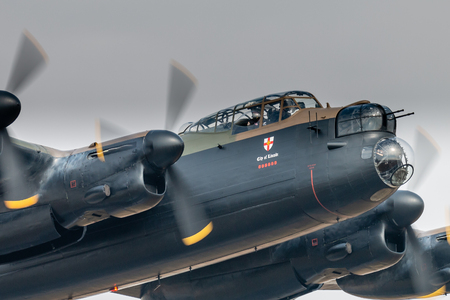 RAF FAIRFORD, ENGLAND - July 13, 2018: An Avro Lancaster Bomber of the Battle of Britain Memorial Flight at the Royal International Air Tattoo 2018 at RAF Fairford, England