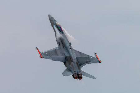 RAF FAIRFORD, ENGLAND - July 13, 2018: A Finnish Air Force FA-18 fighter jet performing at the Royal International Air Tattoo 2018 at RAF Fairford, England
