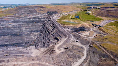 Aerial drone view of a huge opencast coal mine cut into a rural hilly area Reklamní fotografie