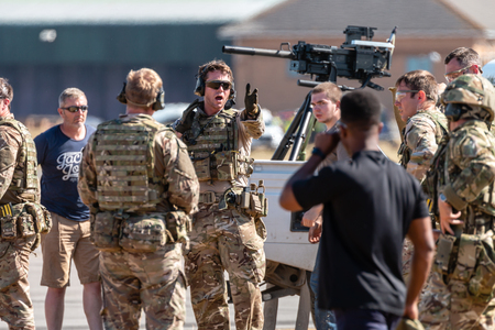 RNAS YEOVILTON, ENGLAND - July 07, 2018: Armoured vehicles and commandos performing at the Yeovilton International Air Day as part of the Helicopter Force Role Demo at RNAS Yeovilton, England