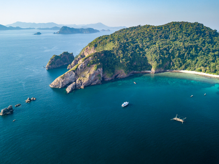 A SCUBA diving boat moored off a beautiful tropical island in the Mergui Archipelago in Myanmar