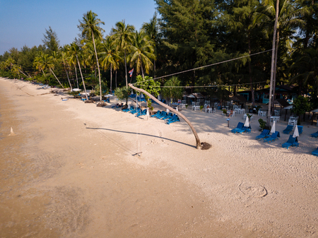 Aerial drone view of a beautiful empty sandy beach and tropical coastline