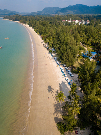 Aerial view of late afternoon shadows being cast onto a beautiful tropical sandy beach in Thailand (Coconut Beach, Khao Lak) Stock Photo