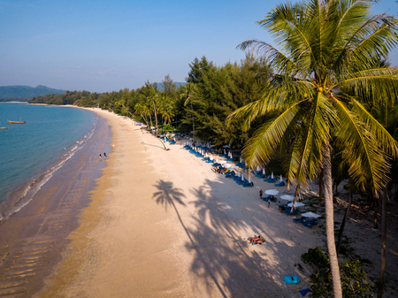 Beautiful late evening shadows on a deserted tropical beach viewed from the air