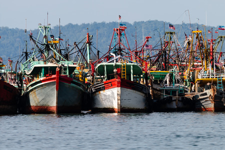 A fleet of fishing boats moored at port in Asia Stock Photo