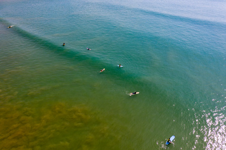Aerial view of surfers in shallow water in Khao Lak, Thailand Stock Photo