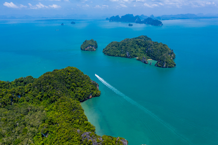 Aerial view of beautiful lush green tropical islands with remote, empty bays and beaches