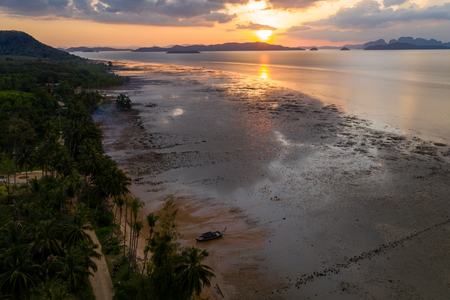 Aerial view of a colorful tropical sunset over a beach and calm ocean Banco de Imagens