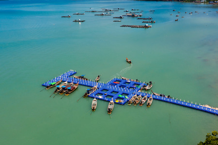 Aerial view of traditional wooden fishing boats in Thailand