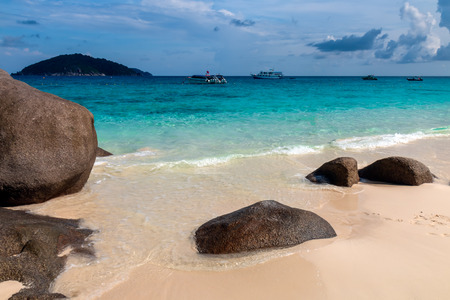 Beautiful clear ocean and deserted tropical sandy beach in the Similan Islands, Thailand