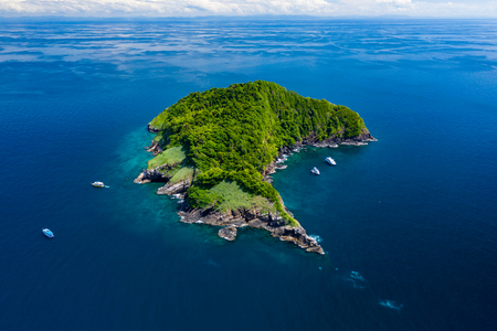 Aerial drone view of a remote, beautiful tropical island surrounded by coral reef (Ko Bon, Thailand)