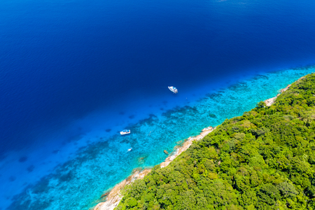 Aerial drone view of diving and snorkel boats around the beautiful tropical Similan Islands in Thailand Stock Photo - 121965052