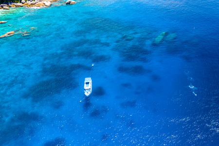 Aerial drone view of diving and snorkel boats around the beautiful tropical Similan Islands in Thailand