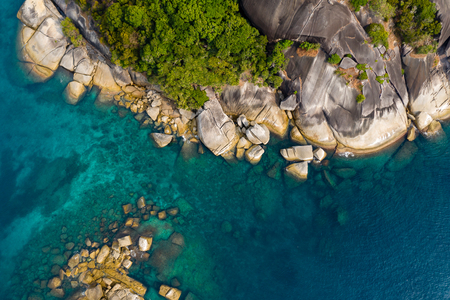 Aerial drone view of a deserted tropical island in a shallow warm ocean (South Twin, Mergui)