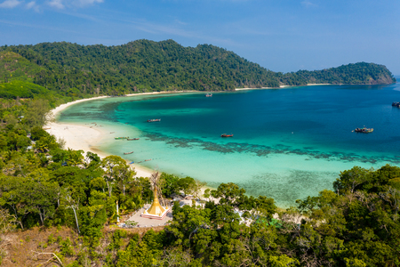 Aerial drone view of a Buddhist pagoda overlooking a tropical sandy beach (Great Swinton Island, Mergui Archipelago, Myanmar)