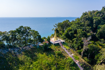 Aerial drone view of a small Buddhist Pagoda on a small tropical island in Myanmar (Swinton Island) Stock Photo