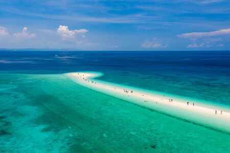 Aerial view of a tiny, tropical sandspit surrounded by coral reef on a small island (Kalanggaman Island) Stock Photo