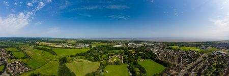 Aerial panorama of Caldicot Castle and both Severn Bridges in the background