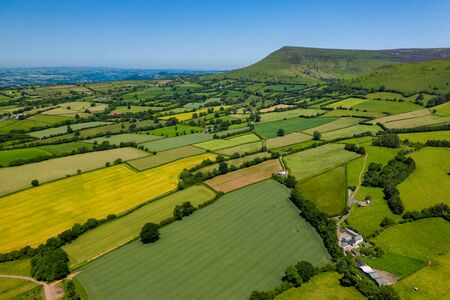 Aerial drone view of fields and mountains in Wales (Llangorse Mountain) Archivio Fotografico