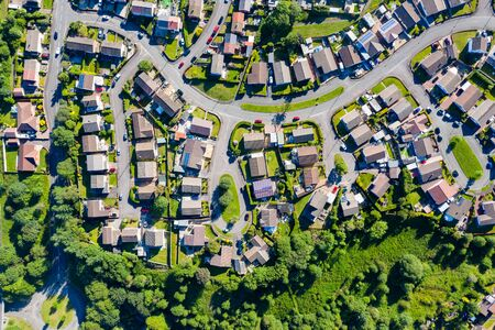 Aerial drone view of small winding sreets and roads in a residential area of a small town Stock Photo