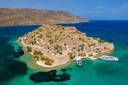 Aerial drone view of the ruins of the ancient Venetian fortress on the island of Spinalonga on the Greek island of Crete Banco de Imagens