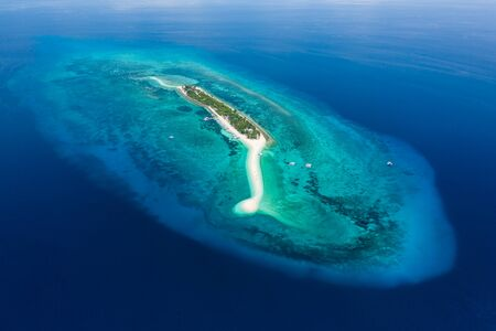 Aerial drone view of a beautiful, tiny tropical island surrounded by coral reef (Kalanggaman Island, Cebu)