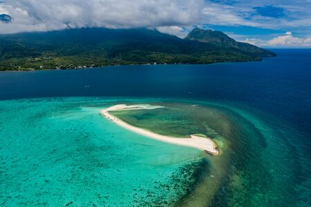 Aerial drone view of the sandy White Island off the coast of Camiguin in the Philippines
