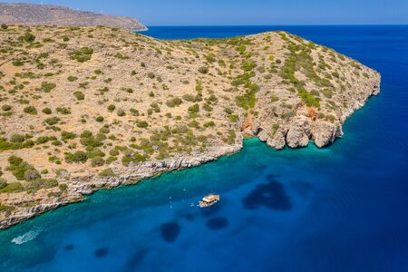 Aerial view of swimmiers and snorkellers in a hot, crystal clear ocean (Crete, Greece)