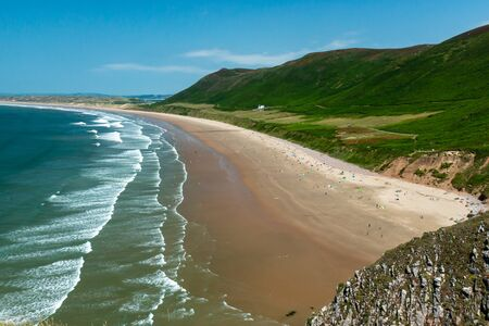 The huge, golden beach at Rhossili in the Gower area of Swansea, Wales