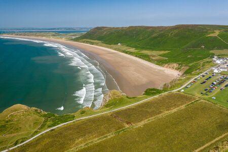 Aerial view of a huge, golden sandy beach and ocean surf 版權商用圖片
