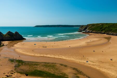 The beautiful, huge sandy beach at Three Cliffs Bay on the Gower Peninsula, Wales