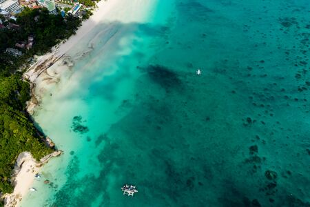 Aerial drone view of Banca boats over a coral reef on the Philippine island of Boracay Reklamní fotografie
