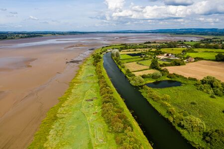 Aerial drone view of abandoned ships on the banks of the River Severn at Purton in England
